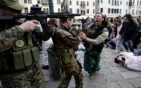 "Participants dressed as zombies and soldiers simulate a fight during a ""Zombie Walk"", part of the Venetian Carnival, in Venice"
